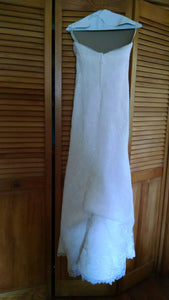 Paloma Blanca 'Strapless Ivory' size 4 used wedding dress back view on hanger