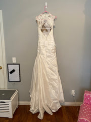 La Soie Bridal '11611' size 6 new wedding dress back view on hanger