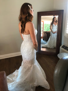 Rivini 'Bullock' size 6 used wedding dress back view on bride
