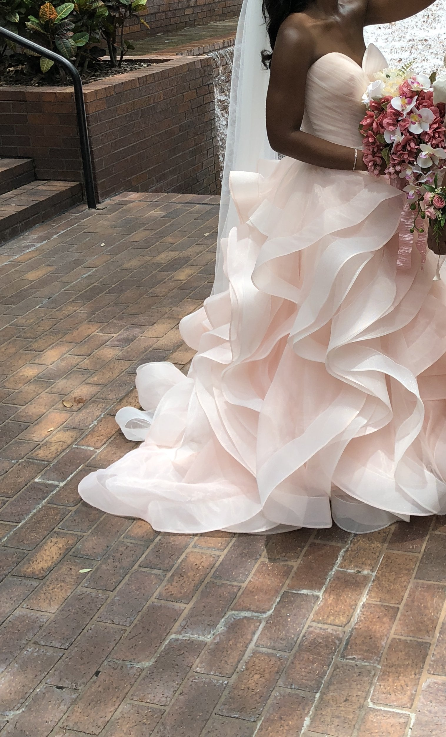 Custom 'Pink Rose' size 8 used wedding dress side view on bride