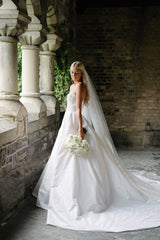 Reem Acra 'I'm Awesome' size 2 used wedding dress side view on bride