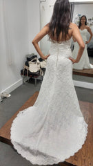 Paloma Blanca 'Modern' size 8 used wedding dress back view on bride