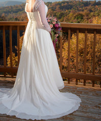 David's Bridal 'Soft Chiffon' size 14 used wedding dress side view on bride