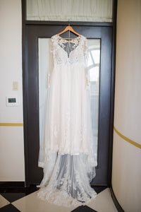 Essense of Australeia 'Illusion Lace' size 14 used wedding dress front view on hanger