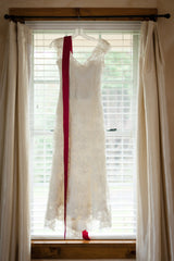 Judd Waddell 'Madeleine' size 10 used wedding dress front view on hanger