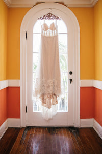 BHLDN 'Lorena' size 8 used wedding dress front view on hanger