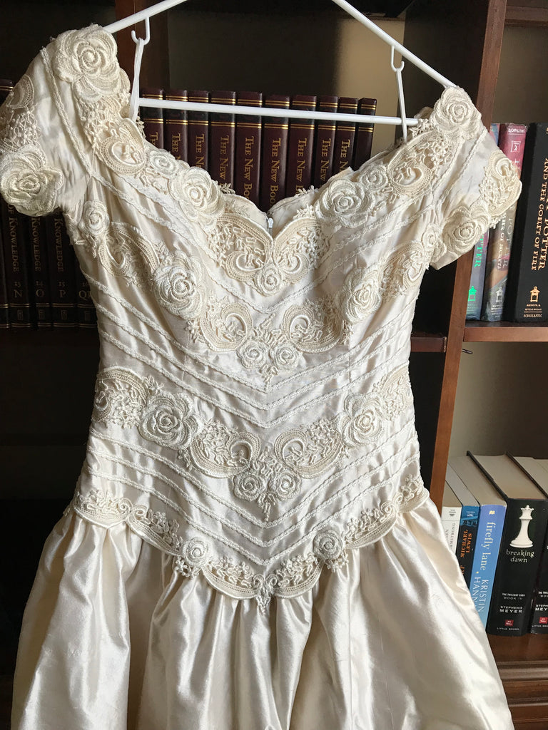Christos 'Silk' size 8 used wedding dress front view on hanger