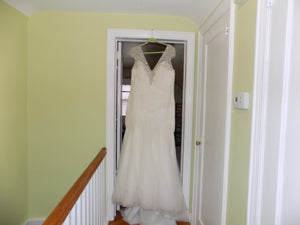 Kleinfeld 'Dina Davos' size 20 sample wedding dress front view on hanger