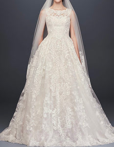 Oleg Cassini 'Beaded Lace' size 6 used wedding dress front view on model