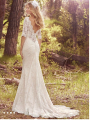 Maggie Sottero 'McKenzie' size 18 new wedding dress back view on model