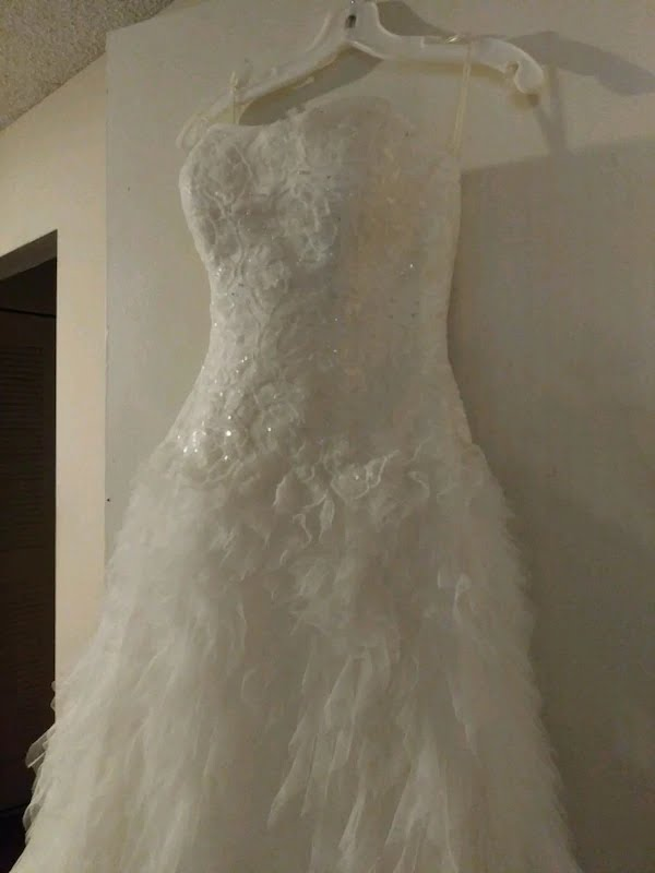Galina Signature 'Swg' size 12 used wedding dress side view on hanger