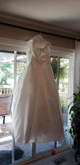 David's Bridal 'Beaded' size 12 new wedding dress front view on hanger