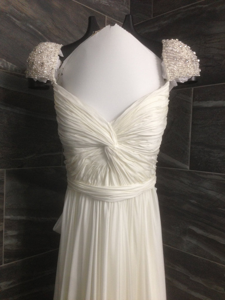 Reem Acra 'Olivia' size 10 used wedding dress front view close up on hanger