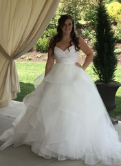 Hayley Paige 'Londyn' size 10 used wedding dress front view on bride