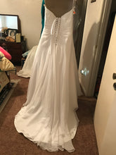 Load image into Gallery viewer, Davids Bridal 'Drape A-Line' size 10 used wedding dress back view on hanger