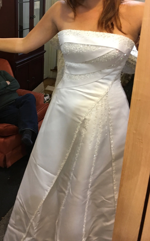 Maggie Sottero 'Haut Couture' size 8 used wedding dress front view on bride