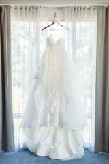 Hayley Paige 'Lulu' size 6 used wedding dress front view on hanger
