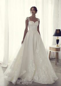 Riki Dalal 'Camil' size 4 used wedding dress front view on model