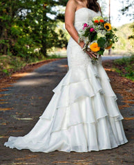 David's Bridal 'Mermaid Tiered Ivory' size 10 used wedding dress front view on bride