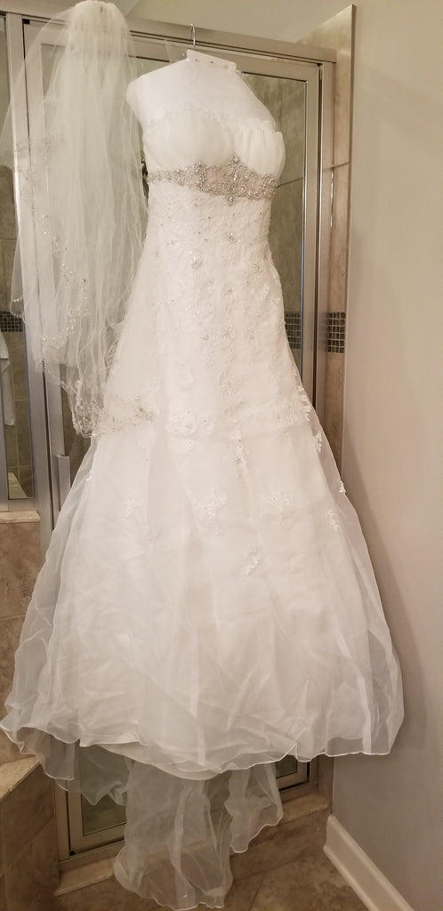 David's Bridal 'Ivory Strapless Organza' size 8 used wedding dress front view on hanger