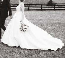 Load image into Gallery viewer, BHLDN 'Octavia' size 4 used wedding dress side view on bride