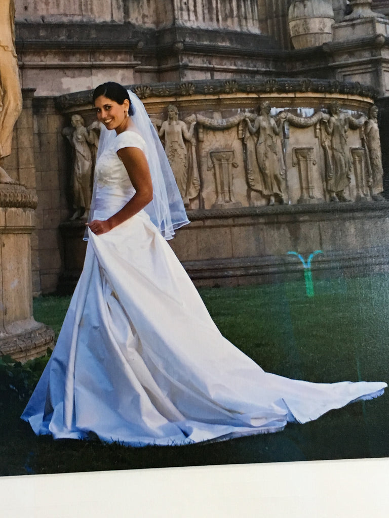 Custom 'Classic Ballgown' size 8 used wedding dress side view on bride