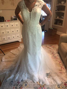 Galina Signature 'Illusion Deep Plunge' size 8 new wedding dress front view on bride