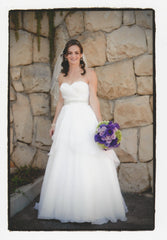 Watters 'Swann' size 6 used wedding dress front view on bride