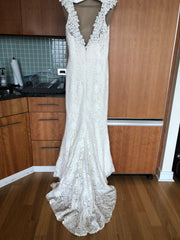 Amy Kuschel 'Avalon Flower Power' size 12 used wedding dress back view on hanger