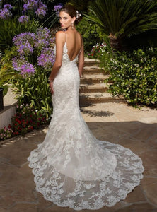 Casablanca 'Exotic Escape 1975' size 4 used wedding dress back view on model