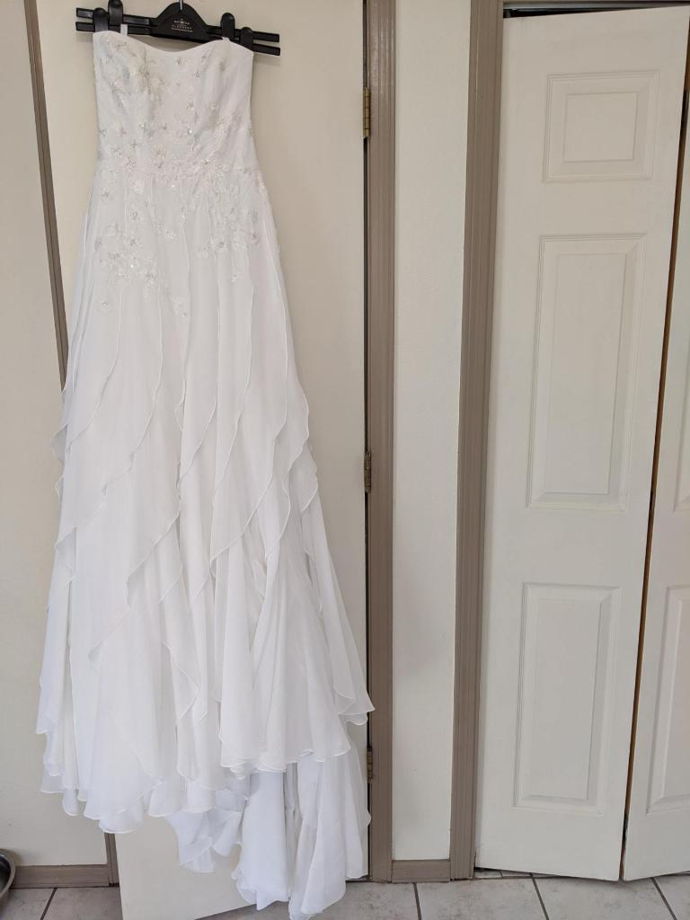 David's Bridal 'Strapless' size 4 used wedding dress front view on hanger