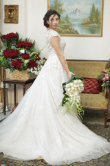Oleg Cassini 'Lace Champagne' size 2 used wedding dress side view on bride