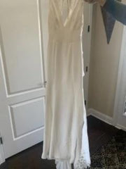 Monique Lhuillier 'V Neck Lace' size 2 new wedding dress front view on hanger