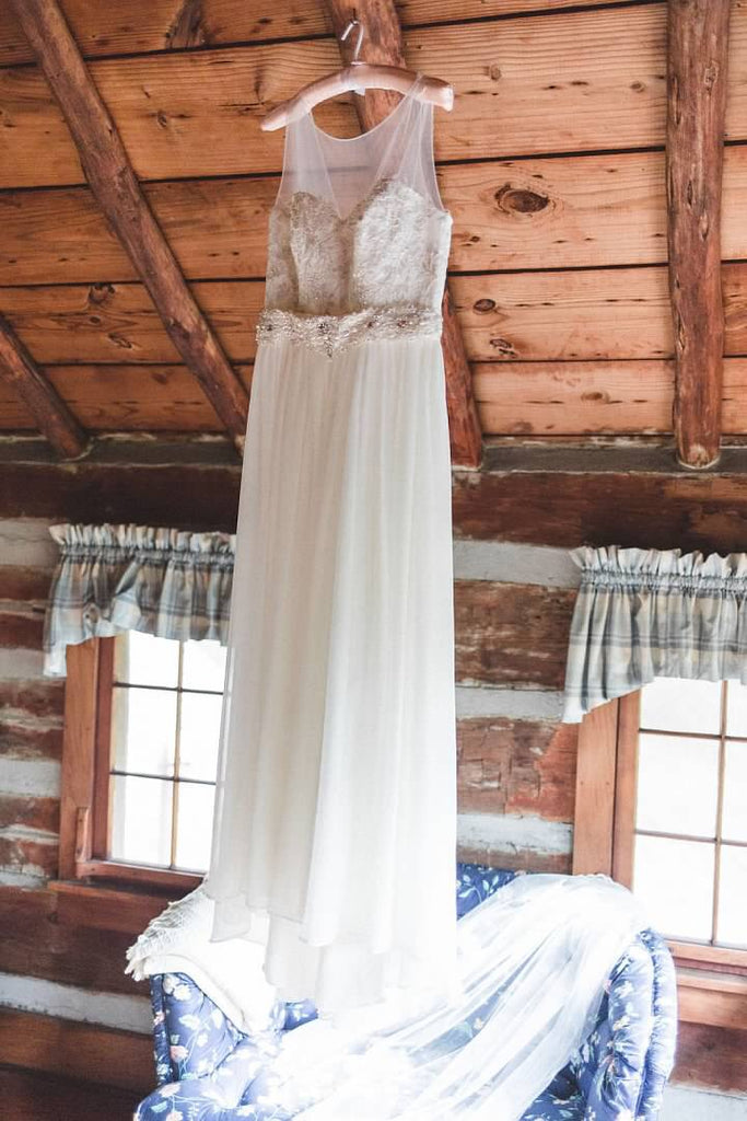 David's Bridal 'Lace and Crinkle Chiffon Sheath' size 10 used wedding dress front view on hanger