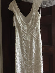 Theia 'Serena' size 6 new wedding dress back view on hanger