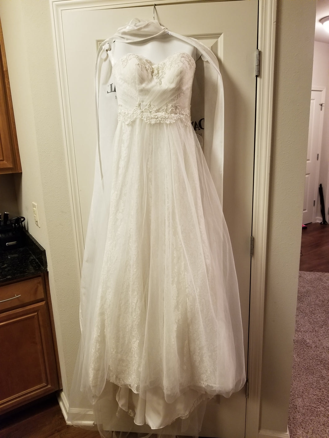 David's Bridal 'Strapless Tulle' size 2 new wedding dress front view on hanger