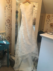 Custom 'Keyhole Back Lace' size 4 new wedding dress front view on hanger