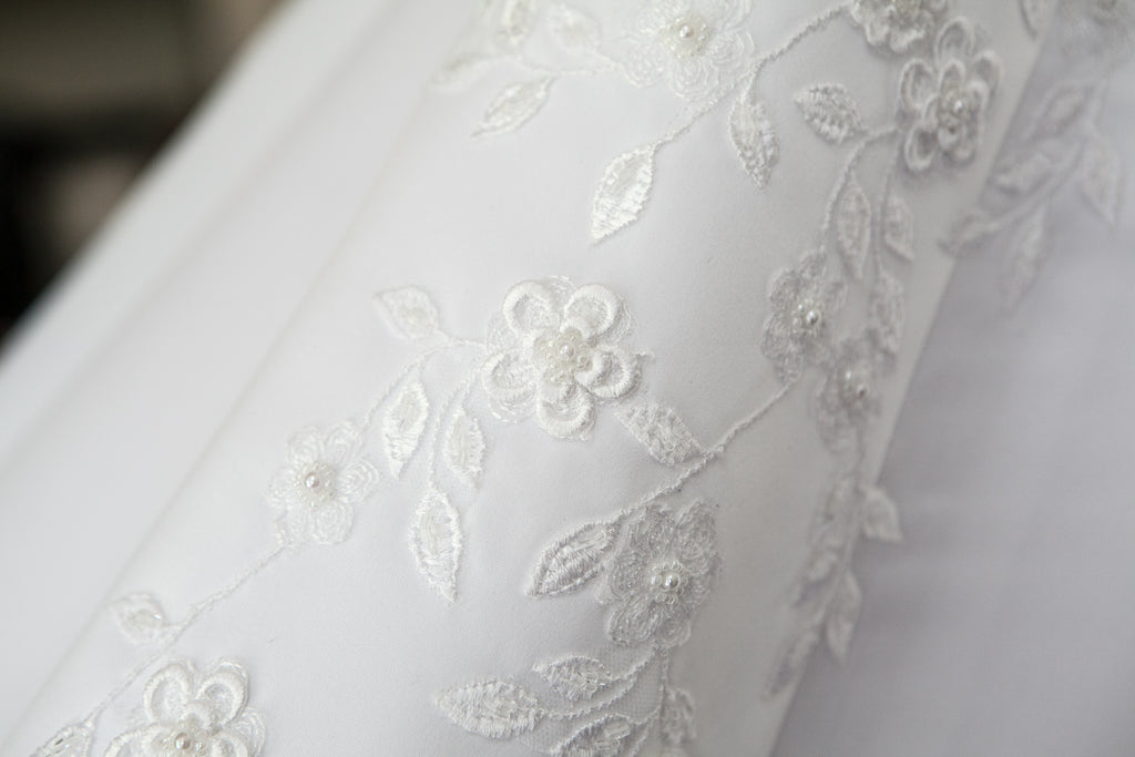 Private Collection 'Lace Overlay Sleeveless' size 14 used wedding dress close up of fabric