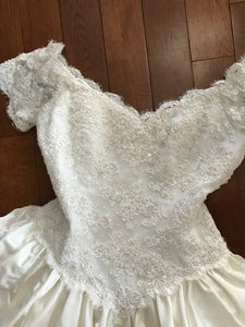 Custom 'Stunning' size 6 used wedding dress front view flat