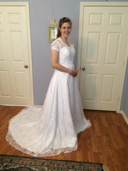Custom 'A Line Princess' size 12 new wedding dress front view on bride