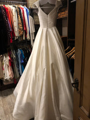 Anne Barge 'Berkeley' size 6 used wedding dress back view on mannequin