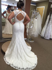 Sweetheart 'Mermaid' size 14 used wedding dress back view on bride