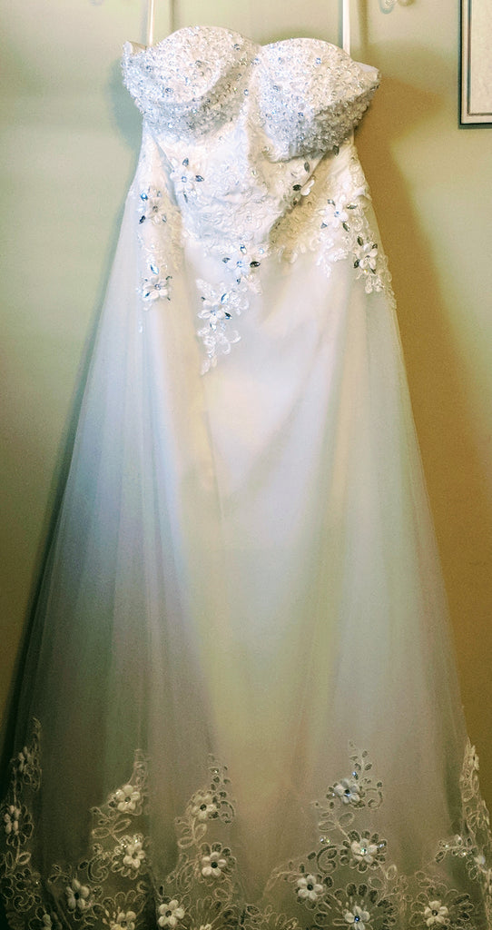 Custom 'Olivia' size 10 used wedding dress front view on hanger