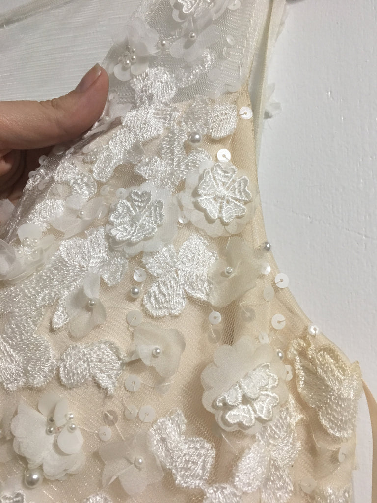 BHLDN 'Ariane' size 12 used wedding dress view of flowers