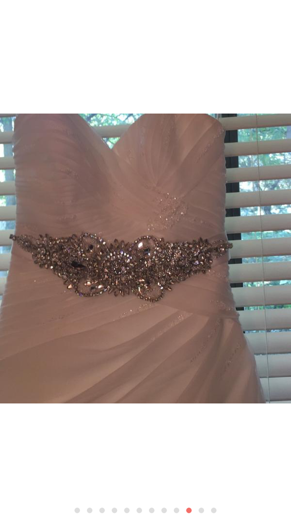 Pronovias 'Sweetheart Sparkle Princess' size 6 used wedding dress front view close up on hanger