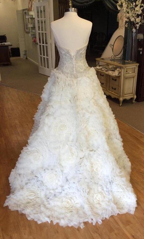 Kenneth Pool 'Anastasia' size 2 used wedding dress back view on mannequin