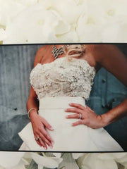 Monique Lhuillier 'Meringue' size 4 used wedding dress front view on bride