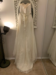Modern Trousseau 'Ryan' size 10 used wedding dress back view on hanger