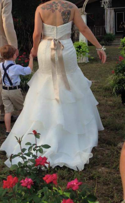 David's Bridal 'Mermaid Tiered Ivory' size 10 used wedding dress back view on bride