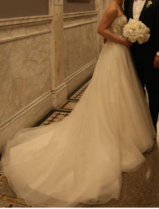Maggie Sottero 'Lorenza' size 4 used wedding dress side view on bride